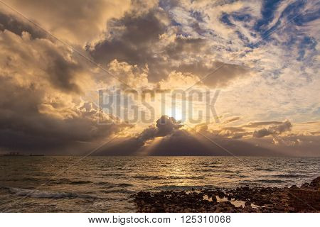 Dramatic Light With Sun Rays And Heavy Clouds