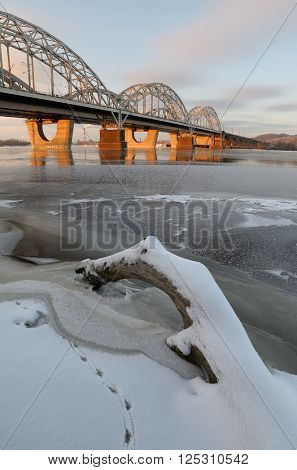 Winter landscape. Bridge over the river. Morning light. Dnieper River, city of Kiev. Ukraine, Europe