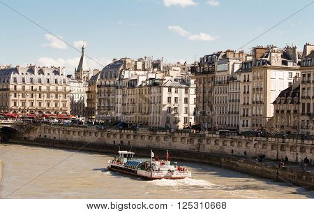 Paris France-April 10 2016 : The view of parisian houses and Seine river Paris France.