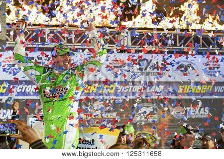 Ft. Worth, TX - Apr 10, 2016: Kyle Busch (18) celebrates in victory lane after winning the Duck Commander 500 at the Texas Motor Speedway in Ft. Worth, TX.