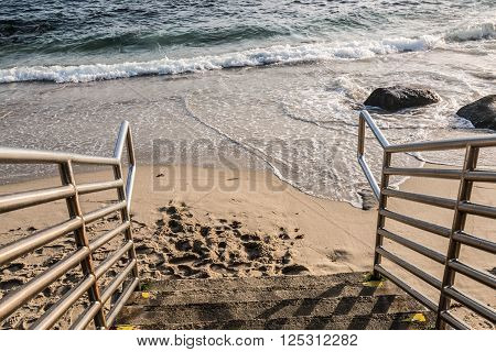 Beach stairs leading down in La Jolla, California.