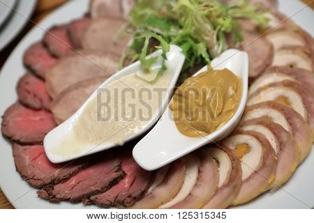 Slices Of Meat With Mustard