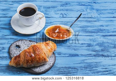 Croissant On A Ceramic Board