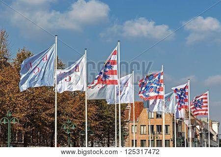 BREUGES, BELGIUM - OCTOBER 13, 2015: Street in Bruges Belgium with flags representing the city's symbols.