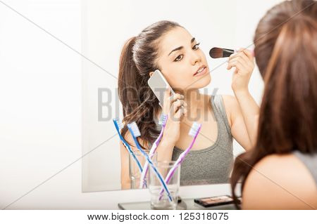 Putting On Makeup And Talking On The Phone