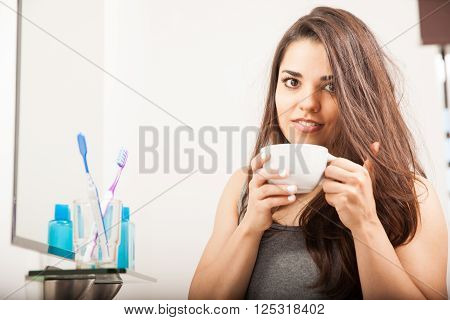 Cute Brunette Waking Up With Some Coffee