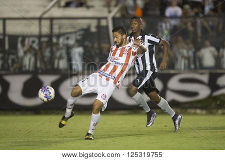 Rio de Janeiro Brasil - April 09 2016: Arthur Sanches and Ribamar player in match between Vasco da Gama and Madureira by the Carioca championship in the S ** Note: Visible grain at 100%, best at smaller sizes