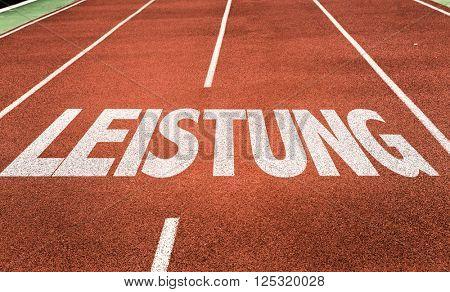 Achievement/Power (in German) written on running track