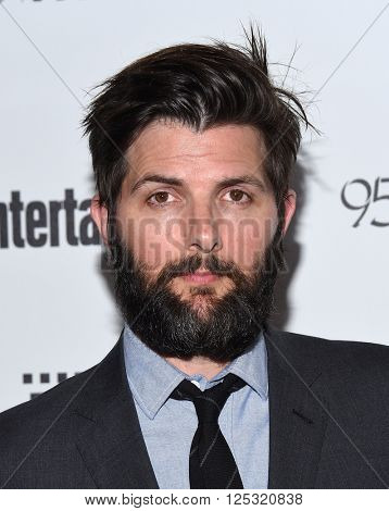 LOS ANGELES - APR 07:  Adam Scott arrives to the Reel Stories, Real Lives  on April 07, 2016 in Hollywood, CA.