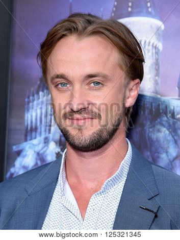LOS ANGELES - APR 05:  Tom Felton arrives to the Wizarding World of Harry Potter Opening  on April 05, 2016 in Hollywood, CA.