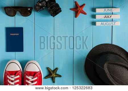 poster of Image of travelling concept. Outfit of traveler, student, teenager, girl or guy. Summer background, Preparation for vacation oand travel. With empty space.