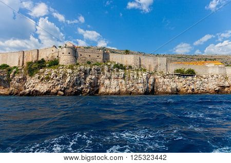 The Walls of Dubrovnik defensive stone walls surrounded Old Town Dubrownik Croatia.