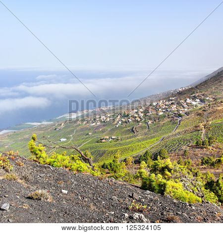 View of La Palma island with small village on the slope, Canary Islands, Spain