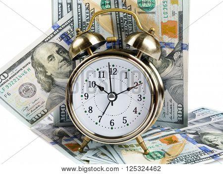Alarm clock and dollar banknotes