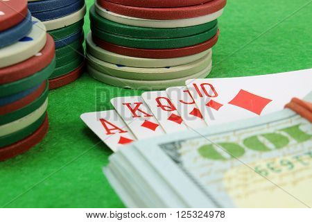 Royal Flush money and chips in the background cloth