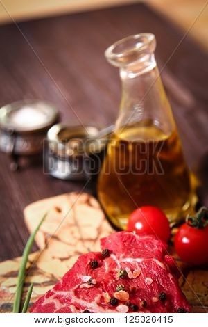 Piece Of Raw Meat With Herbs And Olive Oil