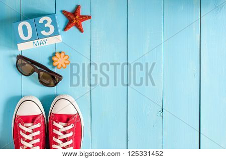 May 3rd. Image of may 3 wooden color calendar on blue background.  Spring day, empty space for text.  International or World Press Freedom Day.