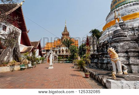 Courtyard and Buddhist stupa structure of Wat Buppharam temple in Chiang Mai Thailand. Historical importance temple was established in 1497 by King Muang Kaew
