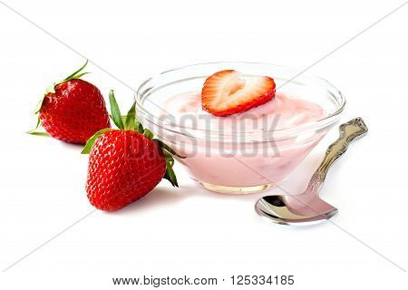 Clear Bowl Of Strawberry Flavored Yogurt With Spoon And Fresh Berries Over A White Background
