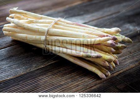 Organic white asparagus on vintage wooden background