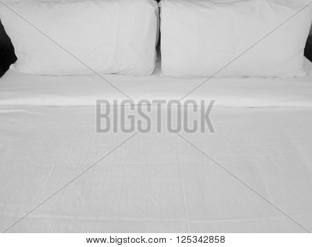 Detail of bed with set of crisp white bed