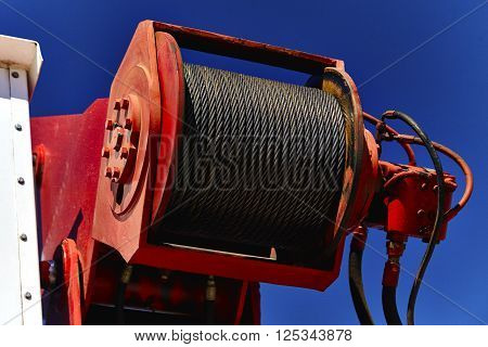 Close up of steel cable on a boom crane hoist
