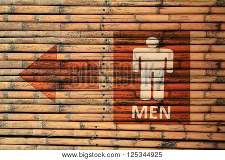 Male Toilet Signs on brown bamboo wood wall