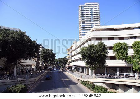 TEL AVIV, ISRAEL - APRIL 7, 2016 : Cityscape with Dizengoff Street, Tel Aviv, Israel. Dizengoff Street is a one of the major street in central Tel Aviv named after Tel Aviv's first mayor Meir Dizengoff.