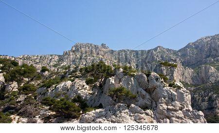 Rocky cliffs tower over the Mediterranean Sea