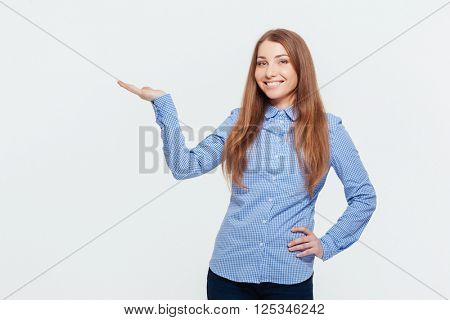 Smiling woman holding copyspace on the palm isolated on a white background