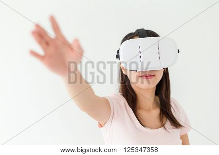 Woman feeling frighten when watching though vr device