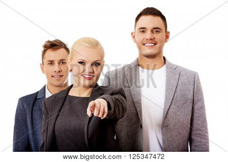 Business team-woman pointing at camera