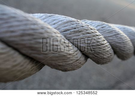 White Twisted Rope (White painted twisted rope against gray concrete).