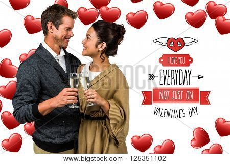 Happy romantic couple with champagne flute against cute valentines message
