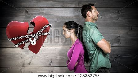 Couple standing back to back against bleached wooden planks background
