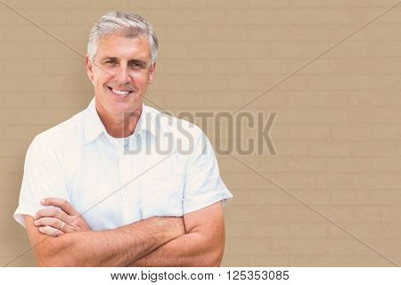 Mature man smiling against white wall