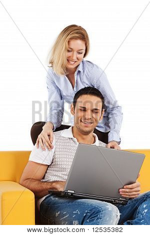 Happy Couple With Laptop Computer