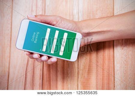 Online banking against feminine hand holding smartphone