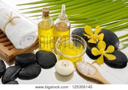 spa background with yellow orchid on towel,oil.leaf