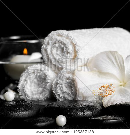 Spa Still Life Of White Hibiscus Flower, Towels And Round Vase With Candle, Pearl Beads On Zen Basal