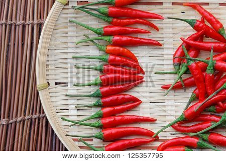 Red chili arranged neatly on rattan tray