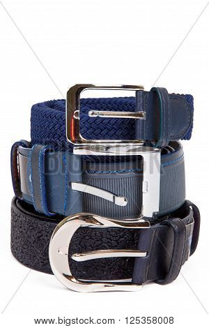 Rolled men's leather belt with metal buckle isolated on white