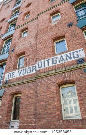 GRONINGEN, NETHERLANDS - APRIL 9, 2016: Detail of an old warehouse at a canal in Groningen, the Netherlands