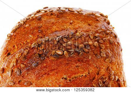 bun of big french rye bread topped with sunflower seeds isolated over white background