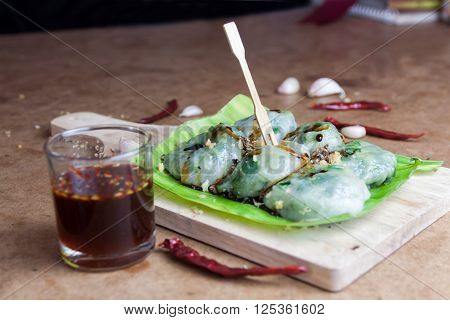 Allium tuberosum. Garlic chives with soy source on babana leaf. Dim sum is chinese cuisine.