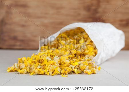 Dry mullein flowers in a paper bag for herbal tea