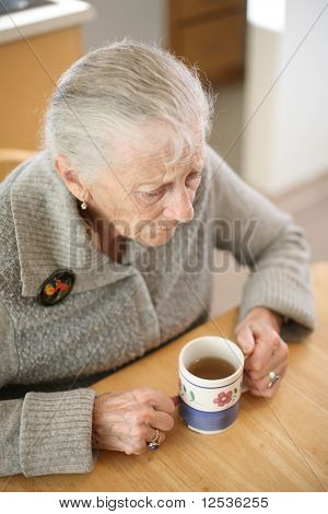 Senior woman with cup of tea
