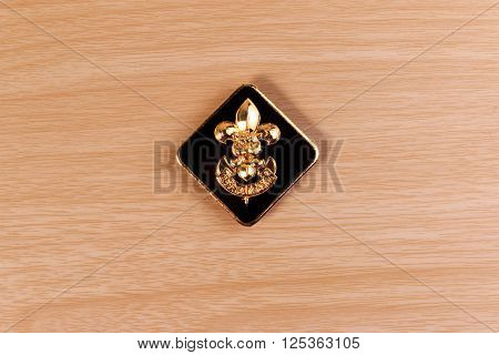 Vintage Boy Scouts Badge On Wooden Table.