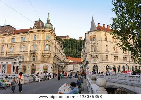 LJUBLJANA SLOVENIA - JULY 9 2009: Triple bridges Kresija building and Philip Mansion