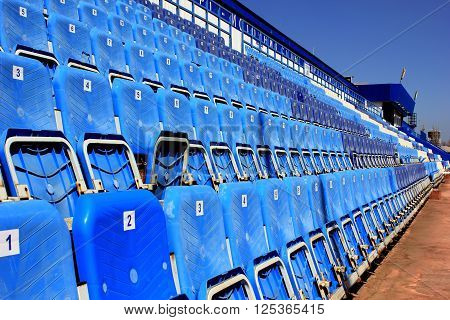 Tribune with folding chairs at small old stadium